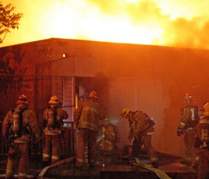 Firefighters working on commercial fire
